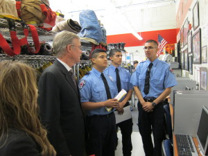 California is spending $1.4 billion to reduce high-school drop-out rates and deepen its pool of technically trained talent by blending academics with career training before students graduate. Carlos Franco (at right with hands clasped), a student at San Jose's Metropolitan Education District, speaks with State Superintendent of Public Instruction Tom Torlakson about the Fire Science and First Responder program. MetroED has gotten a $6 million state grant.