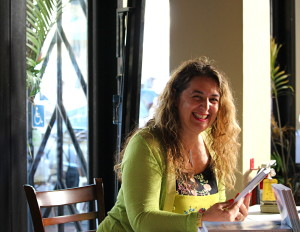 "Samya Boxberger-Oberoi signed copies of her new book ""The Philosophy and Science of Yoga: The Power of Self-Expression 5,000 Years in the Making,"" on July 21 at Roti Indian Bistro in downtown San Mateo. The former tech executive wants to use yoga to spark technological innovation."