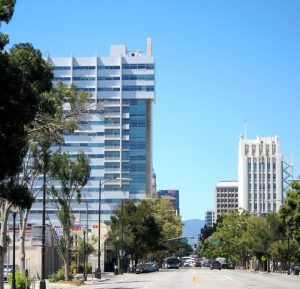 Looking southwest on Santa Clara Street as it enters downtown San Jose. The Richard Meier City Hall rises on the left. The city's new Office of Immigrant Affairs is presenting its three-year 'immigrant integration plan' to the San Jose City Council on May 17. (Photo by Sharon Simonson)